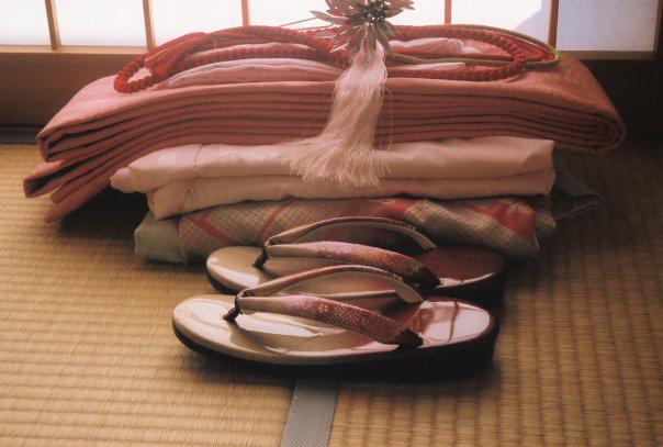 Kimono on floor mat; Osaka, Japan.