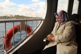 Woman on a ferry; Istanbul, Turkey.