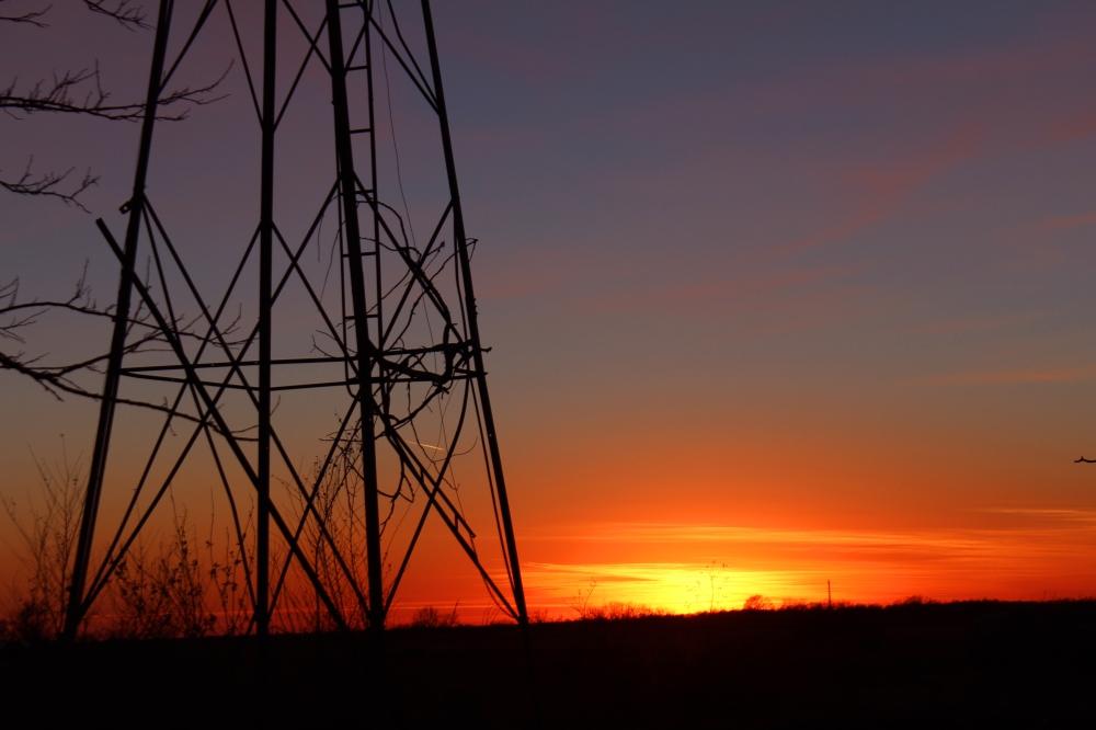 The sun sets by my farm near Haven, Kansas.